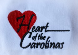 Heart of the Carolinas embroidered logo